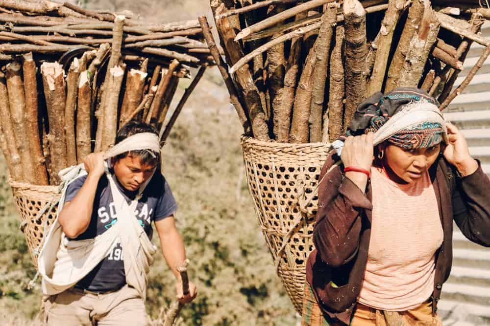 carrying firewood in a village