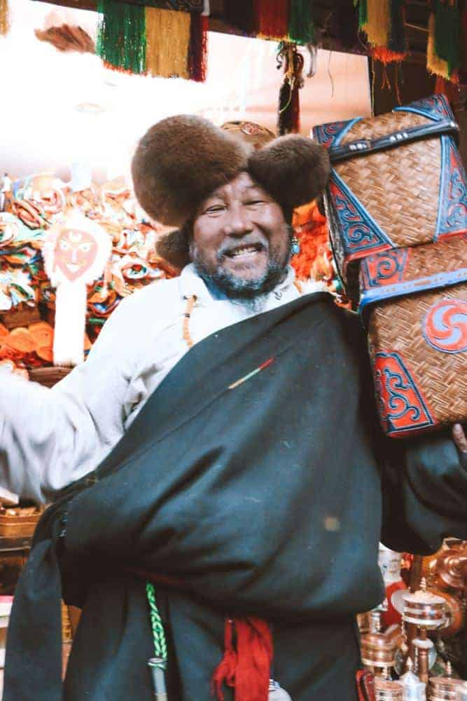 Man selling products in Tibet