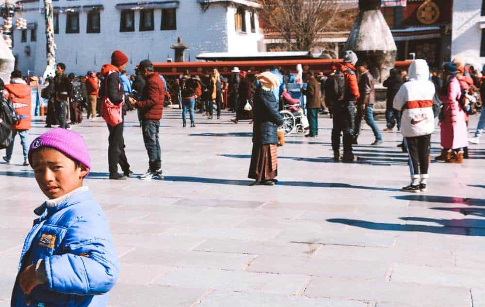 A curious kid in the streets of Tibet