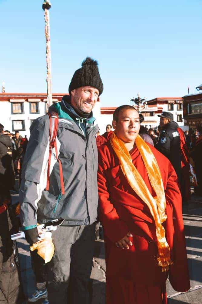 a monk with my husband in Tibet