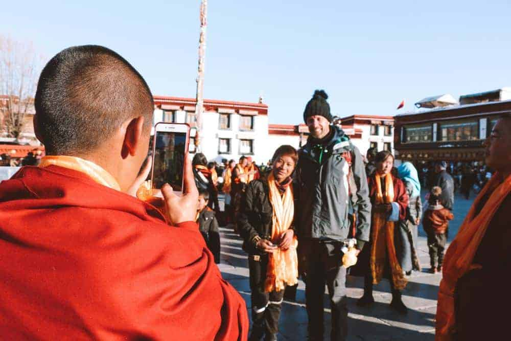 People in Tibet taking pictures with my husband