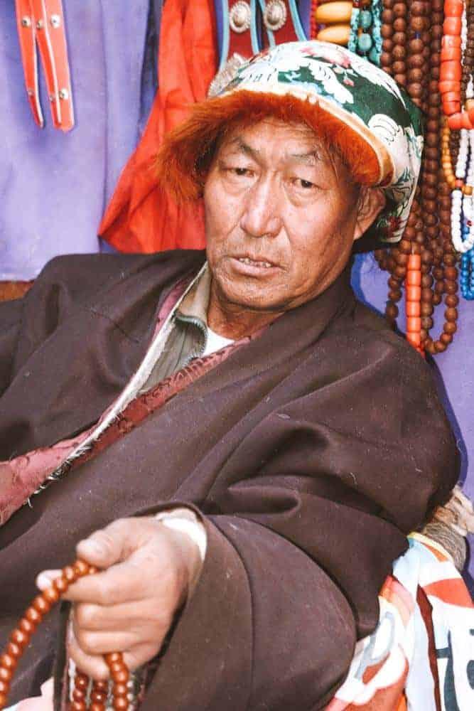 Man praying in Tibet